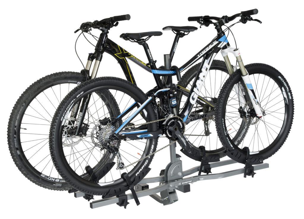 bikes on bike rack product photography white background
