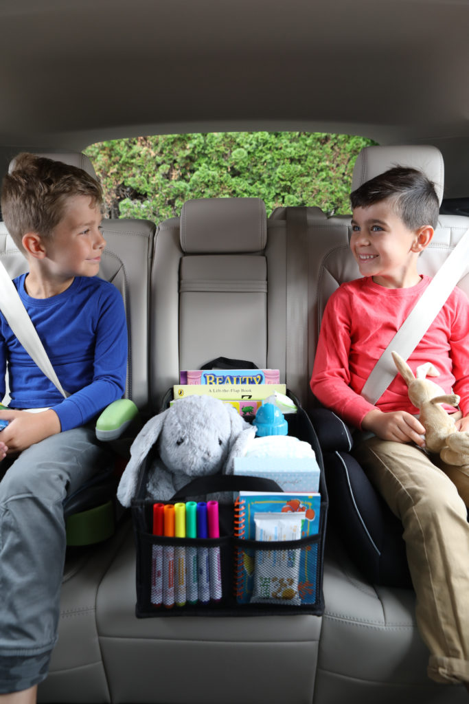 Lifestyle photo of 2 boys in a car with car toy box product