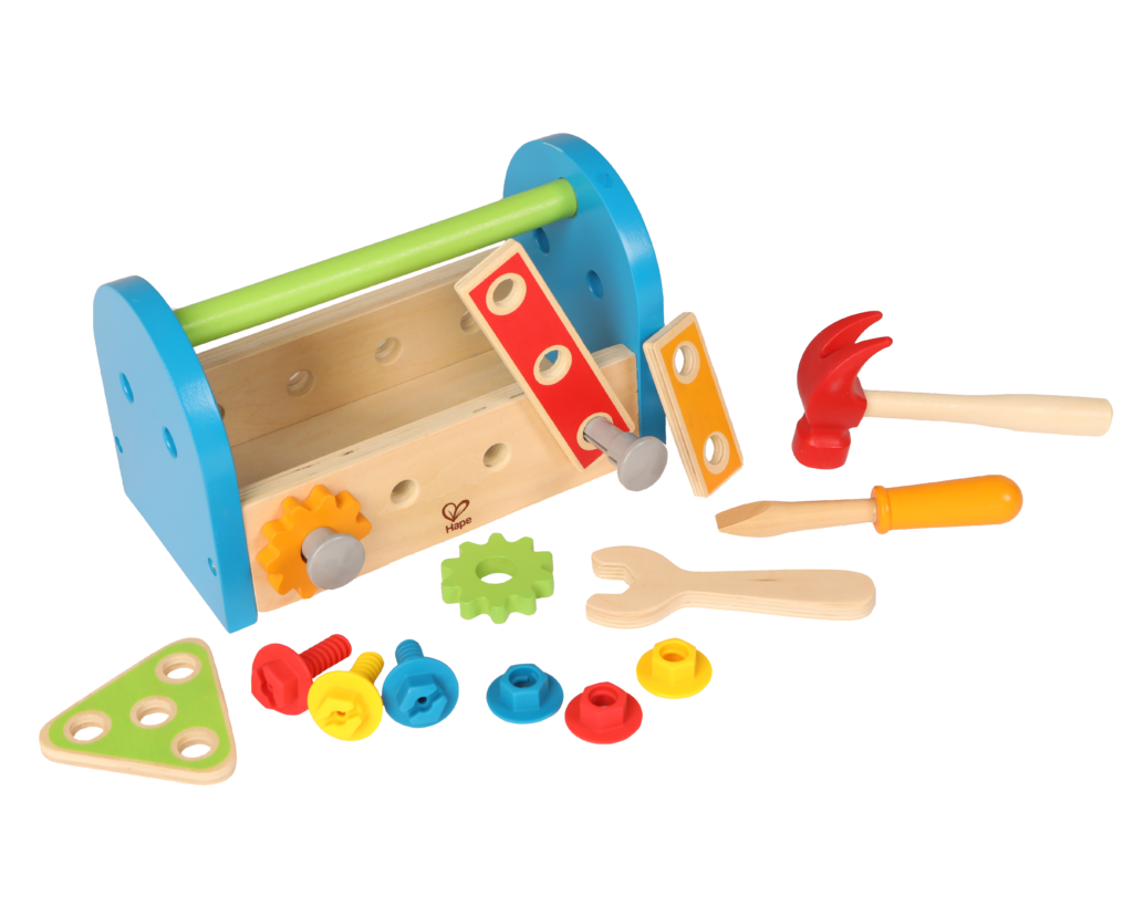 Product photo on transparent background of child wooden tool box in blue, red, green and yellow with toys spread out