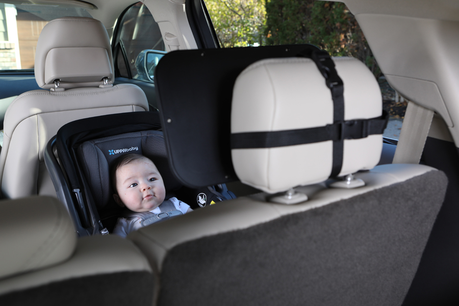 lifestyle photo of a baby in a car seat with baby car product
