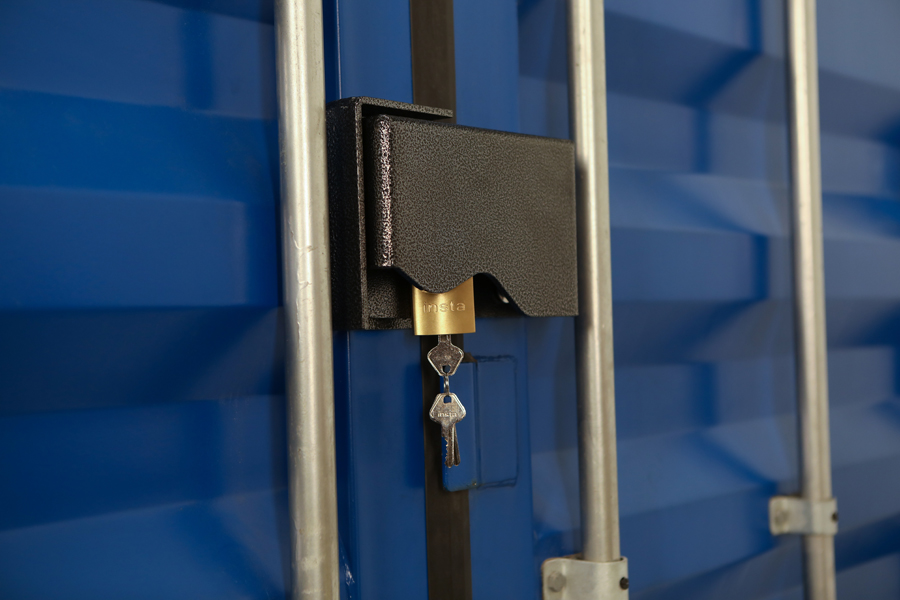 Product photo of lock box and key on a blue steel box