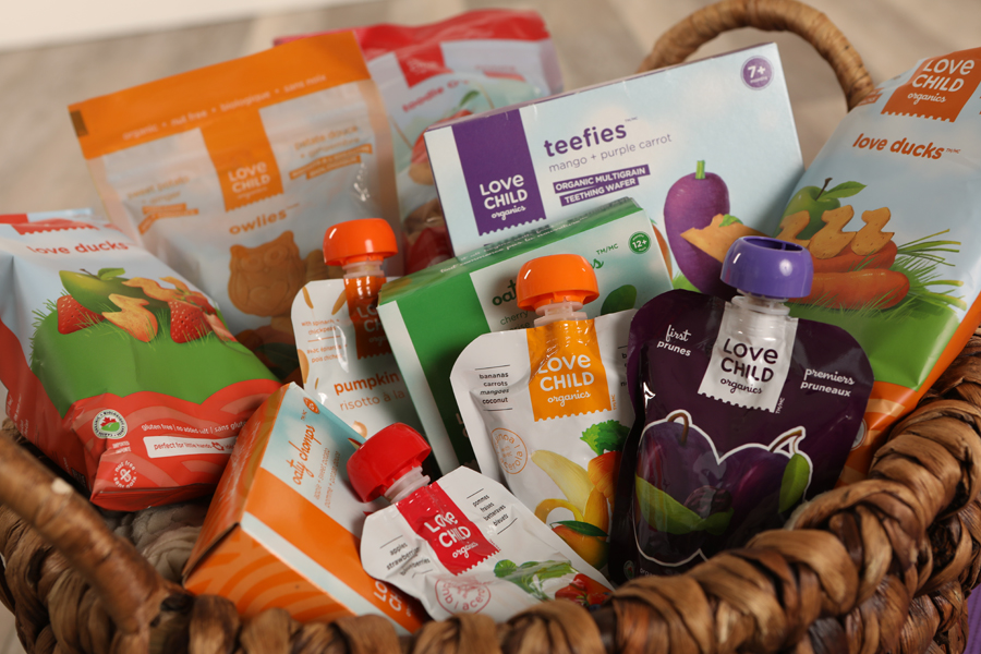 Mini lifestyle photo of basket of baby snacks and drinks